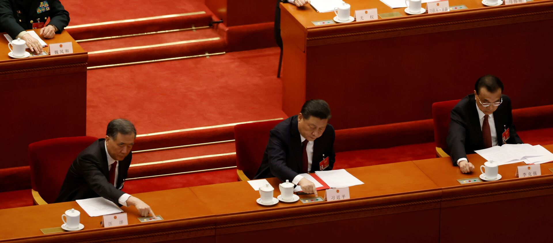 Chinese President Xi Jinping and other leaders cast their votes on Hong Kong electoral reform at the closing session of the National People's Congress (NPC) at the Great Hall of the People in Beijing, China March 11, 2021 - Sputnik International, 1920, 30.03.2021