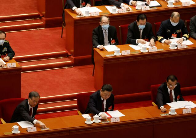 Chinese President Xi Jinping and other leaders cast their votes on Hong Kong electoral reform at the closing session of the National People's Congress (NPC) at the Great Hall of the People in Beijing, China March 11, 2021