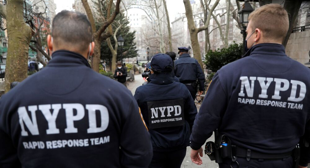 Members of the New York Police Department (NYPD) Community Affairs Rapid Response Team patrol through the Chinatown section of Manhattan following the deadly shootings at three spas in Georgia, in New York City, New York, U.S., March 17, 2021