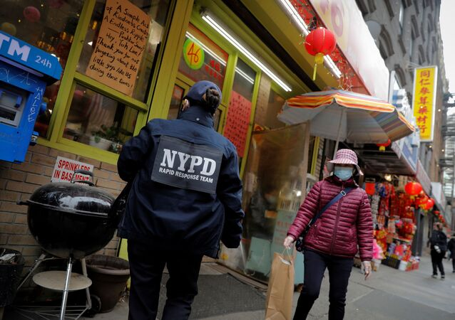 Detective Suk Too, of the New York Police Department (NYPD) Community Affairs Rapid Response Team, checks on businesses in the Chinatown section of Manhattan following the deadly shootings at three spas in Georgia, in New York City, New York, U.S., March 17, 2021