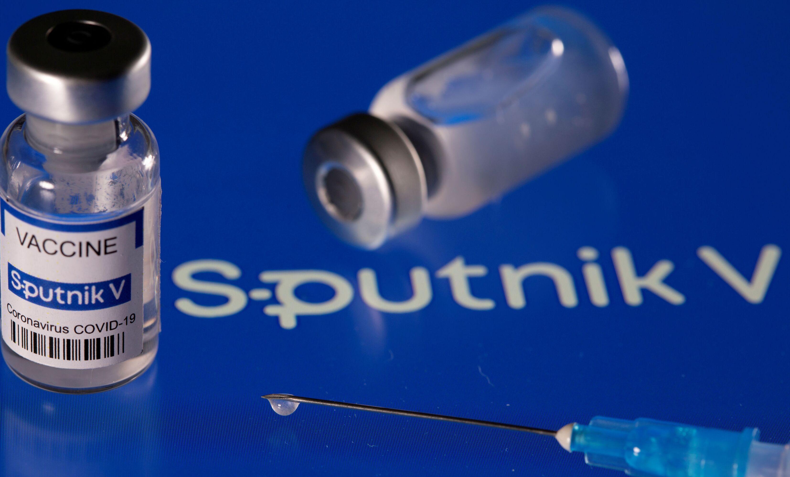 Vial labelled Sputnik V coronavirus disease (COVID-19) vaccine placed on displayed Sputnik V logo is seen in this illustration picture taken March 24, 2021.