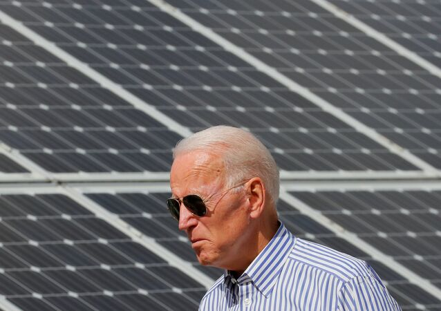 Democratic 2020 U.S. presidential candidate and former Vice President Joe Biden walks past solar panels while touring the Plymouth Area Renewable Energy Initiative in Plymouth, New Hampshire, U.S., June 4, 2019.