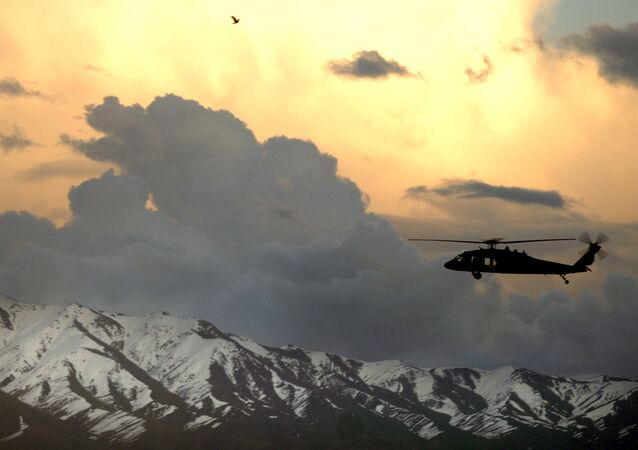 A UH-60 Black Hawk helicopter flies near Bagram Airfield, Afghanistan, March 22, 2007.