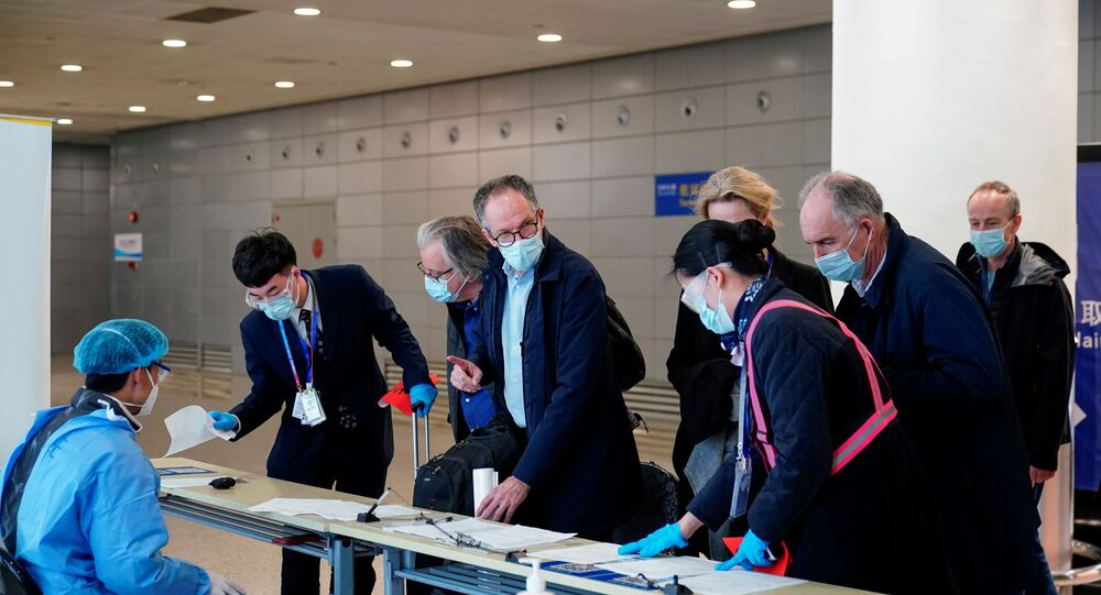 Peter Ben Embarek, and other members of the World Health Organisation (WHO) team tasked with investigating the origins of the coronavirus disease (COVID-19), arrive at the Pudong International Airport in Shanghai, China February 10, 2021.