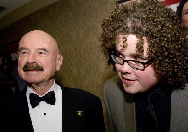 G. Gordon Liddy (pictured, left) chats with American Idol contestant Chris Sligh in 2007