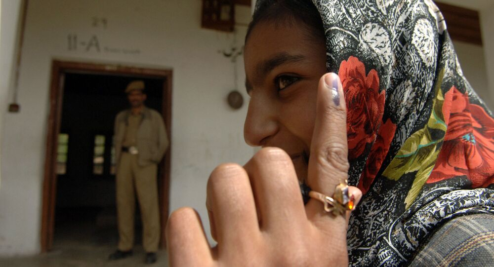 A first time voter showing the ink mark on her finger after casting her vote at a polling booth of Budgam, Srinagar in Jammu & Kashmir during the 4th Phase of General Election-2009 in New Delhi on May 7, 2009