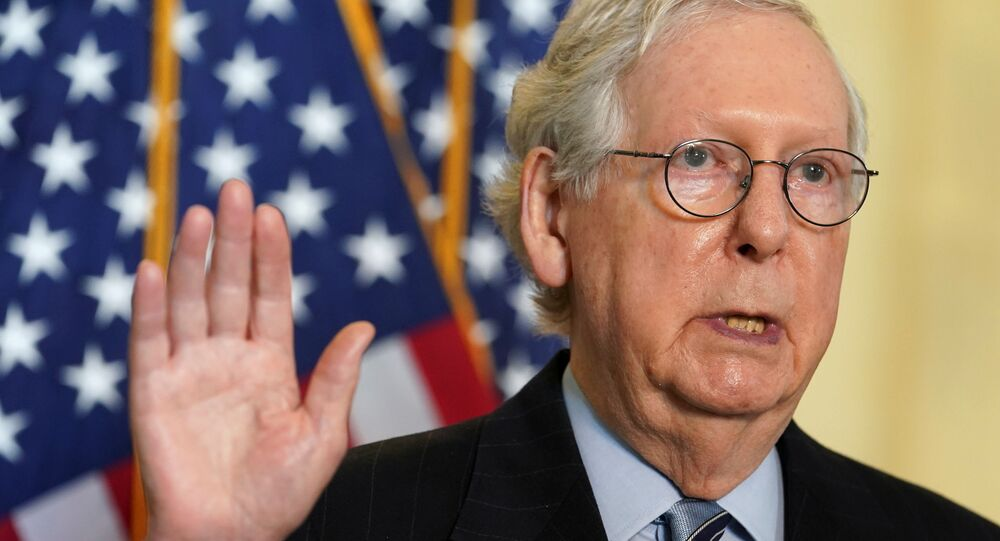Senate Minority Leader Mitch McConnell speaks to reporters after the Senate Republican lunch on Capitol Hill in Washington, U.S., March 23, 2021. REUTERS/Kevin Lamarque