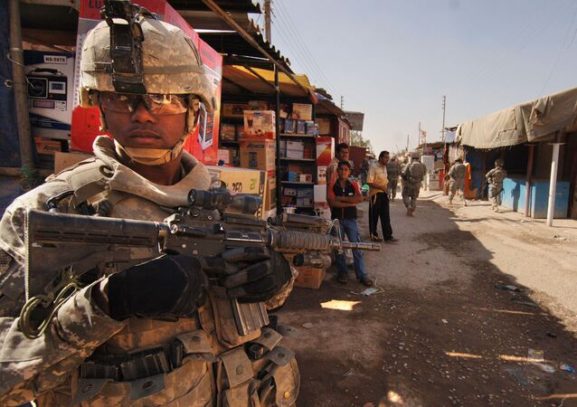 U.S. Army Staff Sgt. Jerrime Bishop provides security during a joint dismounted presence patrol with Iraqi National Police at a market in Narhwan, Iraq, Nov. 1, 2007.