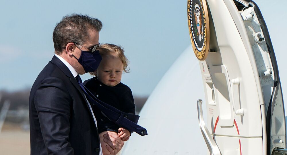 Hunter Biden, son of U.S. President Joe Biden, carries his son Beau to board Air Force One as they depart Washington for travel with President Biden to Wiilmington, Delaware at Joint Base Andrews, Maryland, U.S., March 26, 2021.