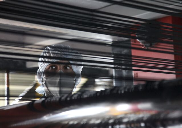 An Iranian worker looks on, in a production line of a carbon fiber factory of the Defense Ministry, in Tehran, Iran, Saturday, Aug. 27, 2011. Iran has inaugurated its own production of carbon fiber, a material under U.N. embargo because of its potential use in the country's controversial nuclear program