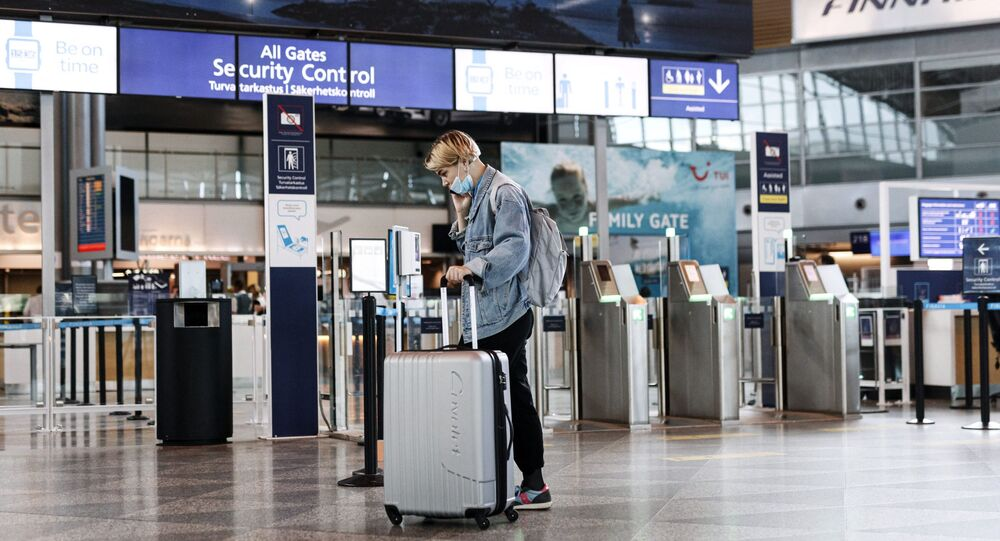 A passenger wears a face mask at the Helsinki-Vantaa airport in Vantaa, Finland on July 13, 2020 as Finnish Government eased COVID-19 pandemic in and out travel restrictions with several EU countries.