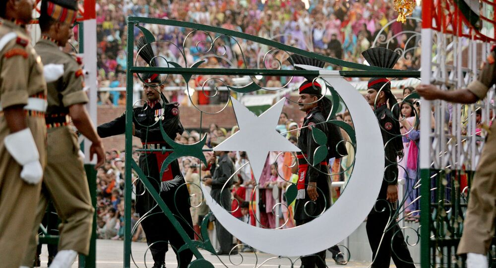 Pakistani Rangers soldiers, center, and Indian Border Security Force soldiers close their respective international gates after the Beating the Retreat or flag off ceremony at the India and Pakistan joint border check post of Wagah, India, Saturday, Aug. 13, 2005