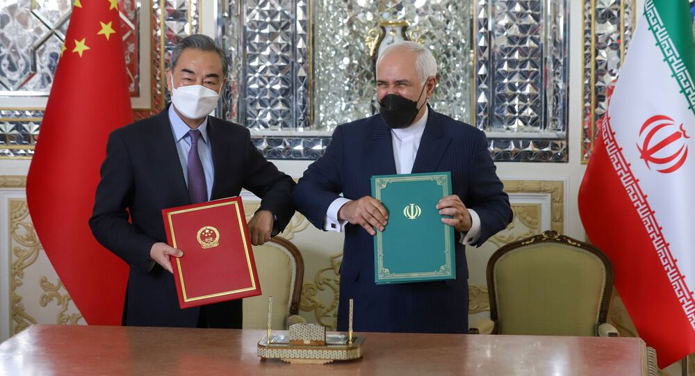 Iran's Foreign Minister Mohammad Javad Zarif and China's Foreign Minister Wang Yi bump elbows during the signing ceremony of a 25-year cooperation agreement, in Tehran, Iran March 27, 2021