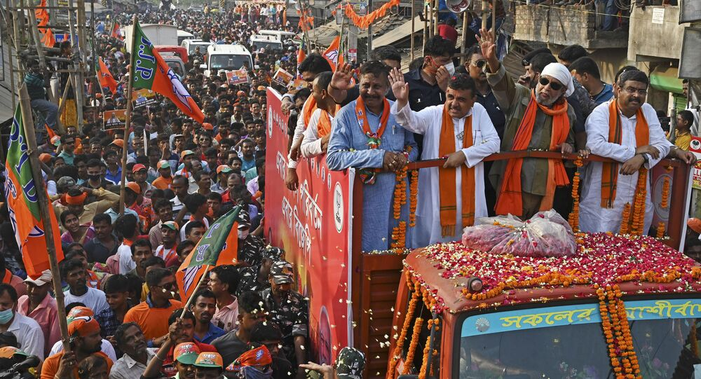 Bollywood actor and Bharatiya Janata Party (BJP)leader Mithun Chakraborty (c, white headgear) with electoral candidate Suvendu Adhikari (c,2L) take part in a road show as a part of election campaign ahead of the 2nd phase of the state Legislative Assembly election in Nandigram around 160 kms west of Kolkata on March 30, 2021