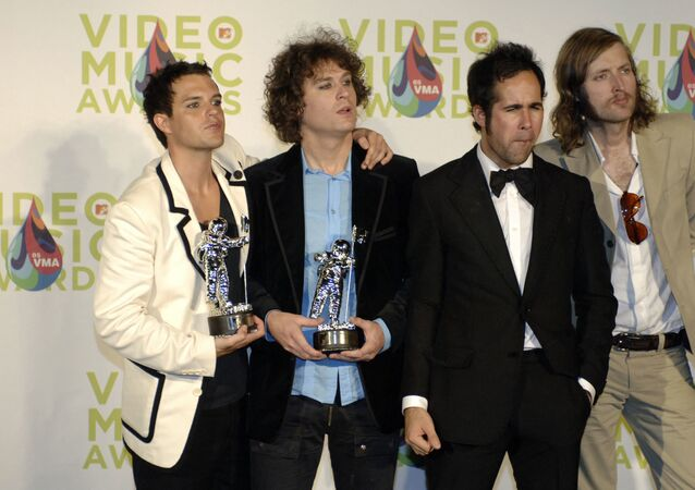 The Killers display the best new artist in a video award they won at the MTV music video awards in Miami 28 August 2005 for their song Mr. Brightside.