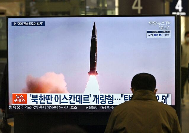 A man watches a television screen at Suseo railway station in Seoul on March 26, 2021, showing news footage of North Korea's latest tactical guided projectile test.