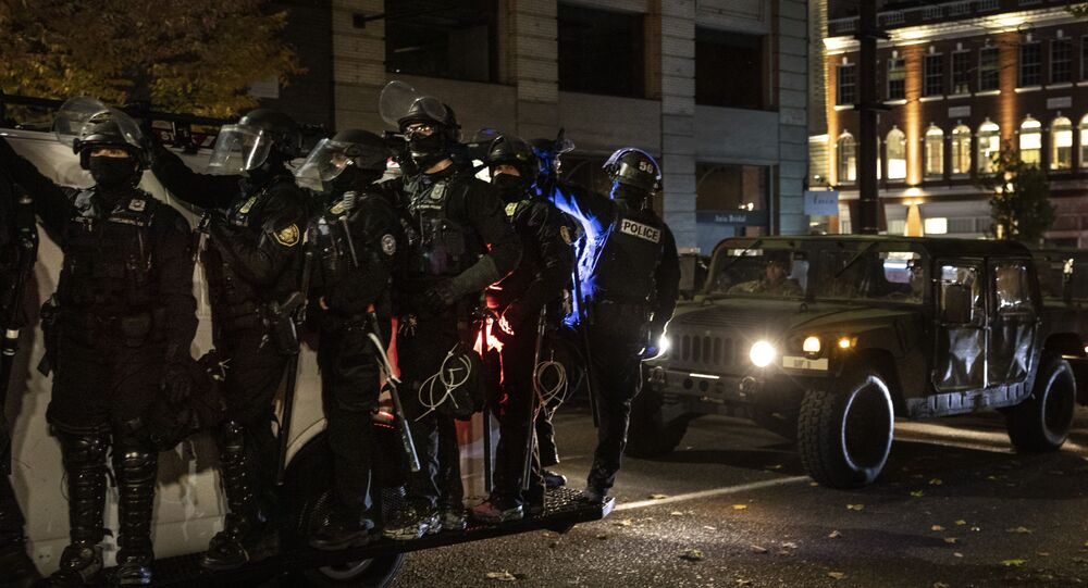 Police join the national guard during protests following the Nov. 3 presidential election in Portland, Or. Wednesday, Nov. 4, 2020.