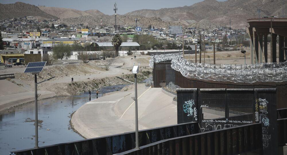 People cross the Rio Grande from Ciudad Juarez, Mexico into El Paso, Texas, Tuesday, March 23, 2021.
