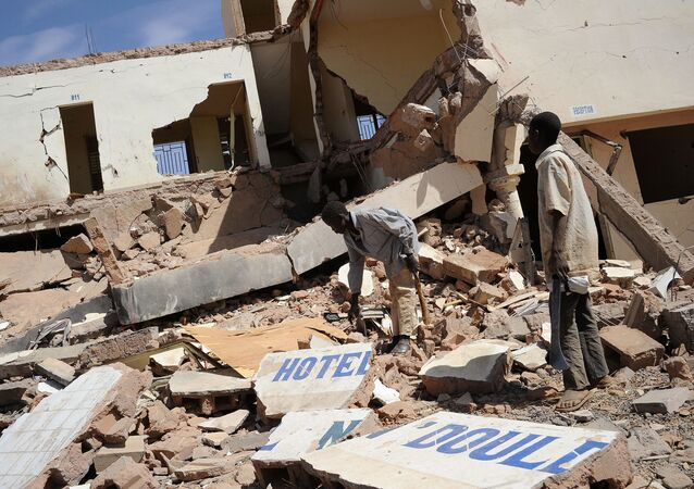 In this file photo children search on February 5, 2013 in the ruins of a hotel destroyed by French air strikes in  Douentza, as he town was retaken by French and Malian troops in January.