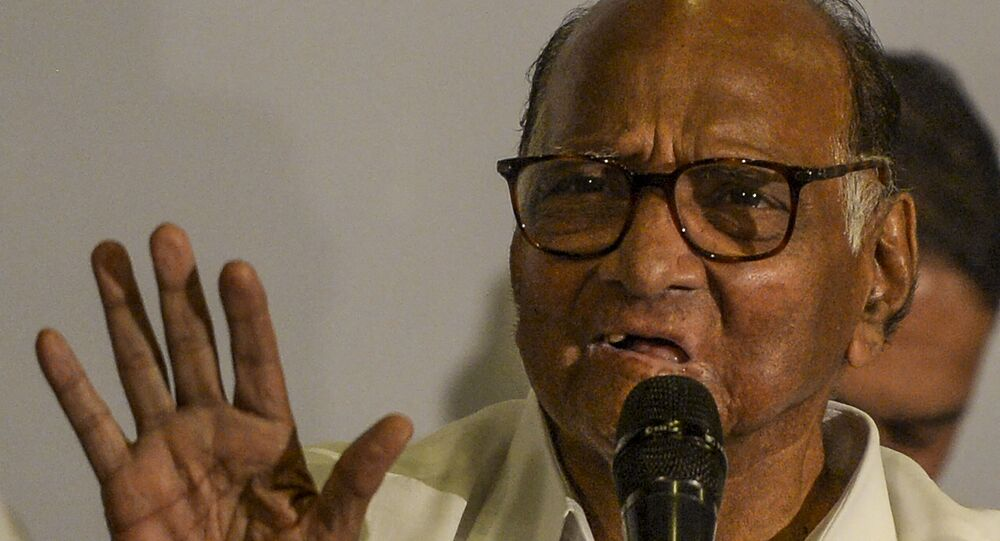 National Congress party president Sharad Pawar gestures as he speaks during a press conference in Mumbai on November 12, 2019.