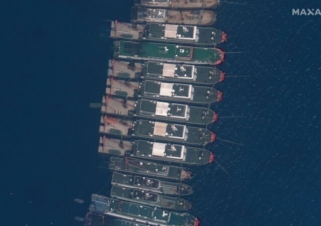 Close up view of fishing vessels anchored at Whitsun Reef, which Manila calls the Julian Felipe Reef, in this Maxar handout satellite image taken March 23, 2021