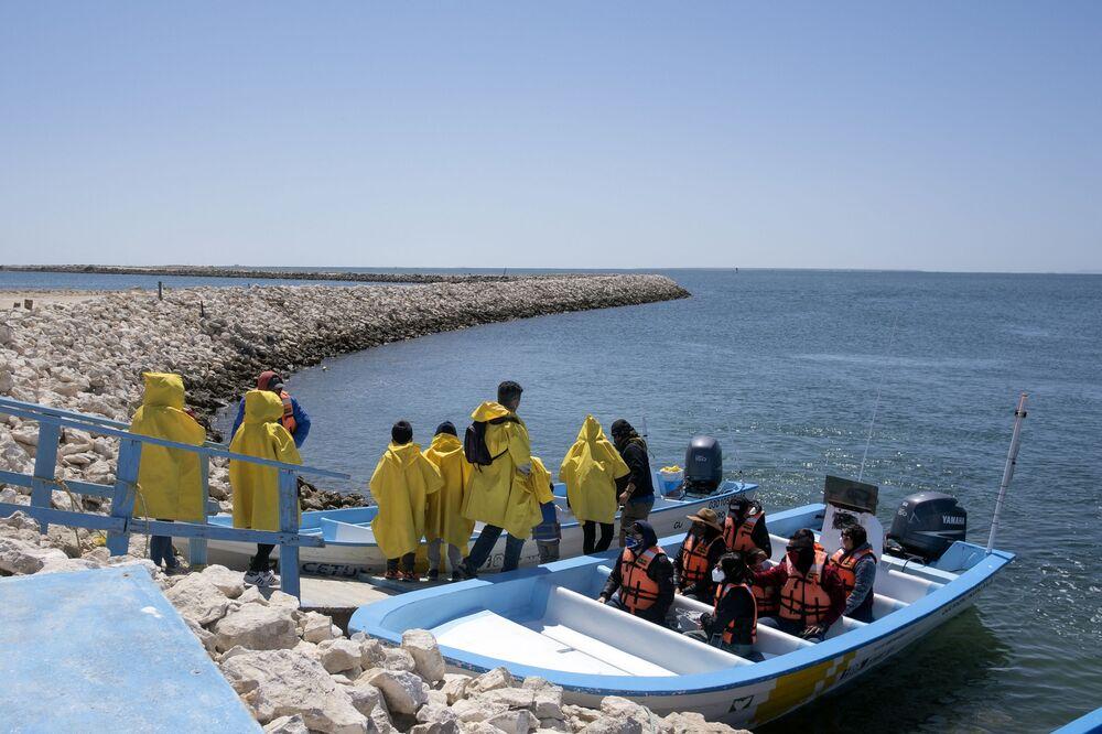 Whale watchers board tour boats at the Ojo de Liebre Lagoon in Guerrero Negro, Baja California Sur, Mexico.