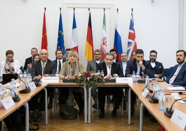 Iranian political deputy at the Ministry of Foreign Affairs of Iran Abbas Araghchi (C-R), and German Secretary General of the European External Action Service (EEAS) Helga Maria Schmid (C-L) attend a meeting of the Joint Commission on Iran's nuclear program (JCPOA) at EU Delegation to the International Organizations office in Vienna, Austria, on December 6, 2019. (Photo by JOE KLAMAR / AFP)