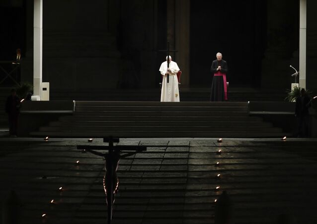 Pope Francis presides over the Via Crucis – or Way of the Cross – ceremony in St Peter's Square devoid of tourists and the faithful, who would normally be flocking to the spot, because of Italy's ban on gatherings to prevent the spread of coronavirus, at the Vatican, Friday, 10 April 2020.