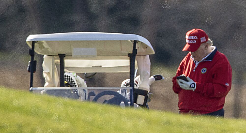 US President Donald Trump makes a phone call as he golfs at Trump National Golf Club on 26 November 2020 in Sterling, Virginia.