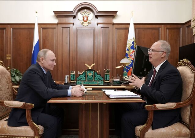 Russian President Vladimir Putin attends a meeting with head of the Russian Direct Investment Fund Kirill Dmitriev in Moscow, Russia April 2, 2021
