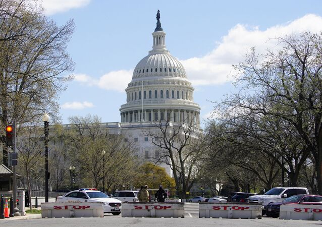 Law enforcement officers guard streets surrounding the U.S. Capitol and congressional office buildings following a security threat at the U.S. Capitol in Washington, U.S., April 2, 2021.