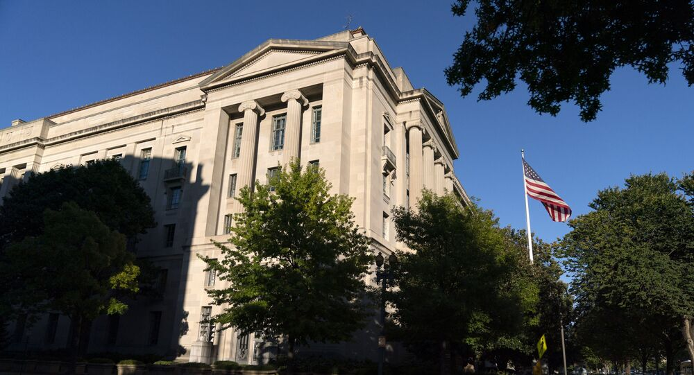 The American flag flies outside of the Justice Department building, Thursday, Oct. 8, 2020, in Washington.