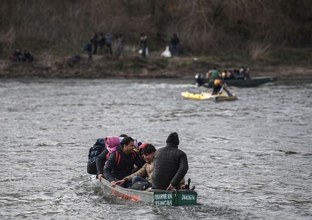 Migrants take boats near Edirne while other migrants wait at Greece side, as they attempt to enter Greece by crossing the Maritsa river, on March 1, 2020.