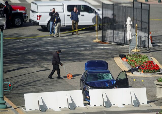 A blue car is seen after ramming a police barricade outside the US Capitol building in an incident that reportedly resulted in the death of one Capitol police officer, the injury of another officer and the death of the driver who was shot by police on Capitol Hill in Washington, DC, US on 2 April 2021.