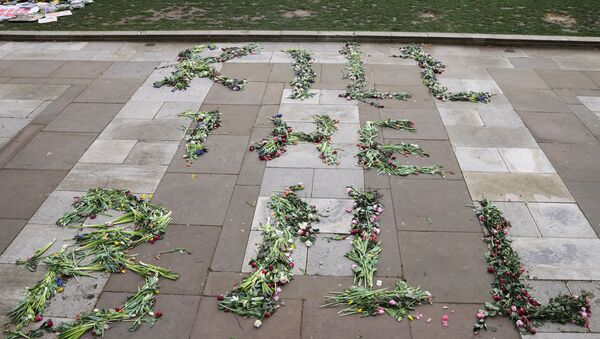 Flowers that spell out the word Kill the Bill are seen on the floor on Parliament Square in London, Britain, March 17, 2021.  - Sputnik International