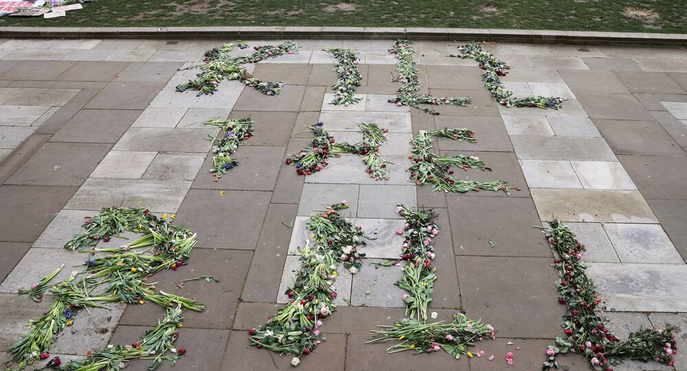 Flowers that spell out the word Kill the Bill are seen on the floor on Parliament Square in London, Britain, March 17, 2021.