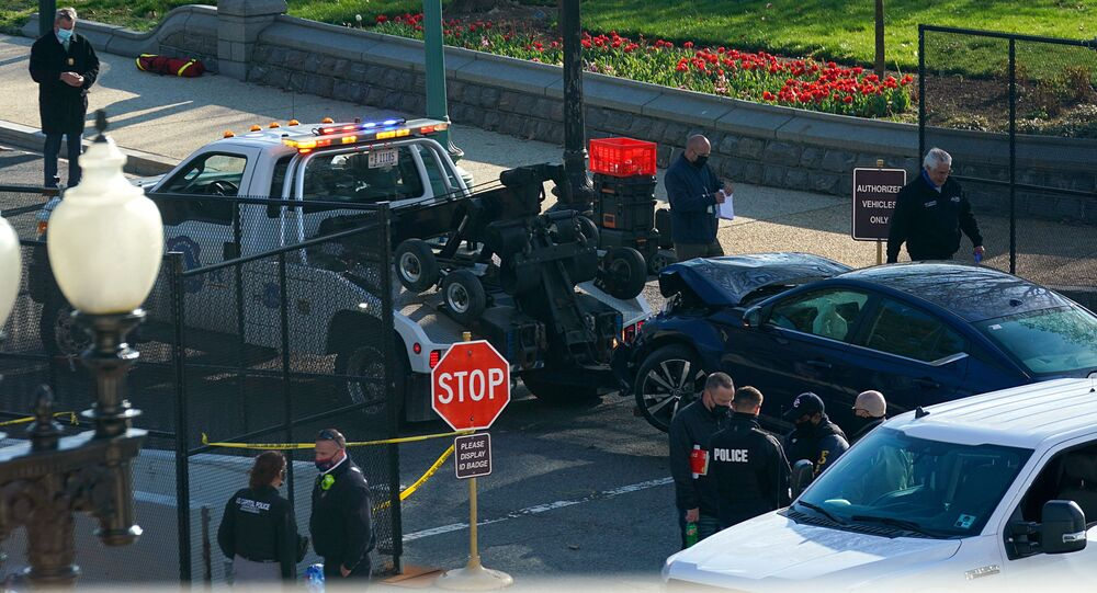 A truck tows away the car used to ram a police barricade outside the US Capitol building on Capitol Hill in Washington, DC, 2 April 2021.