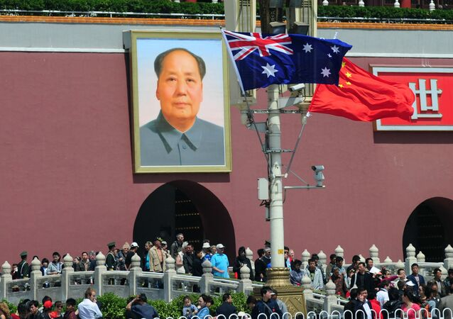 The national flags of Australia and China are displayed before a portrait of Mao Zedong facing Tiananmen Square, during a visit by Australia's Prime Minister Julia Gillard in Beijing on April 26, 2011.  AFP PHOTO/Frederic J. BROWN (Photo by FREDERIC J. BROWN / AFP)