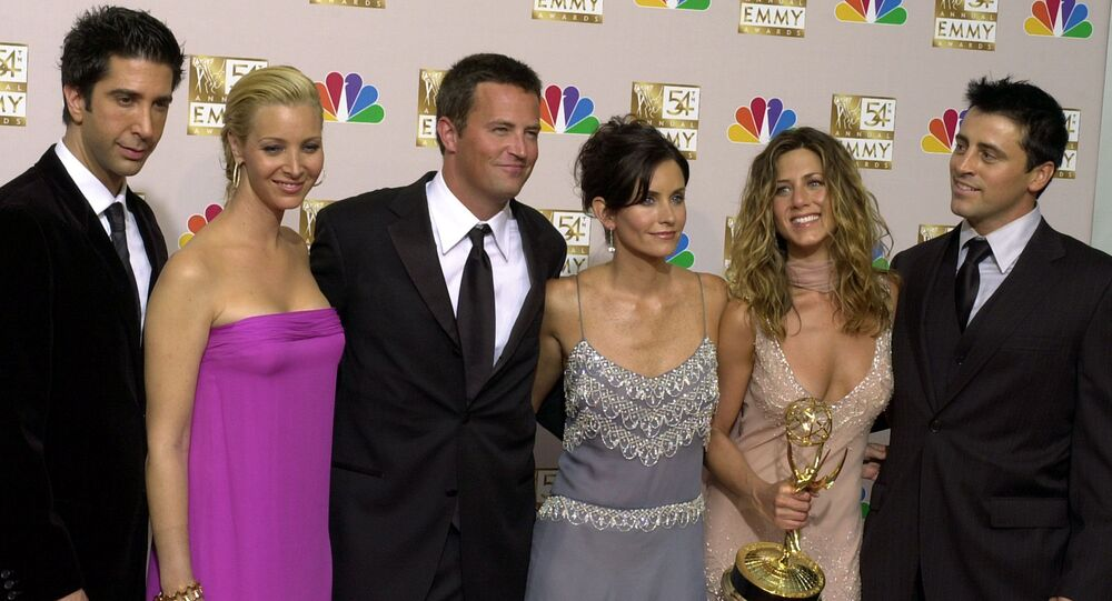 the cast of Friends, from left, David Schwimmer, Lisa Kudrow, Matthew Perry, Courteney Cox, Jennifer Aniston and Matt LeBlanc pose in the press room with the award for outstanding comedy series at the 54th annual Primetime Emmy Awards in Los Angeles.