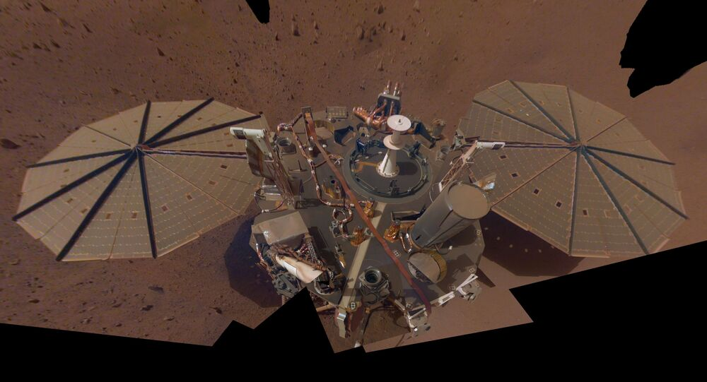This is NASA InSight's second full selfie on Mars. Since taking its first selfie, the lander has removed its heat probe and seismometer from its deck, placing them on the Martian surface; a thin coating of dust now covers the spacecraft as well. This selfie is a mosaic made up of 14 images taken on March 15 and April 11 — the 106th and 133rd Martian days, or sols, of the mission — by InSight's Instrument Deployment Camera, located on its robotic arm.