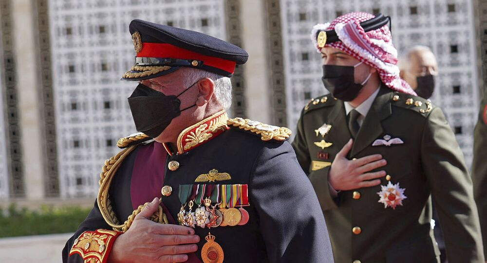 In this photo released by the Royal Hashemite Court, Jordan's King Abdullah II arrives for the inauguration of the 19th Parliament's non-ordinary session to  deliver a speech from the throne, in Amman Jordan, Thursday, Dec. 10, 2020.