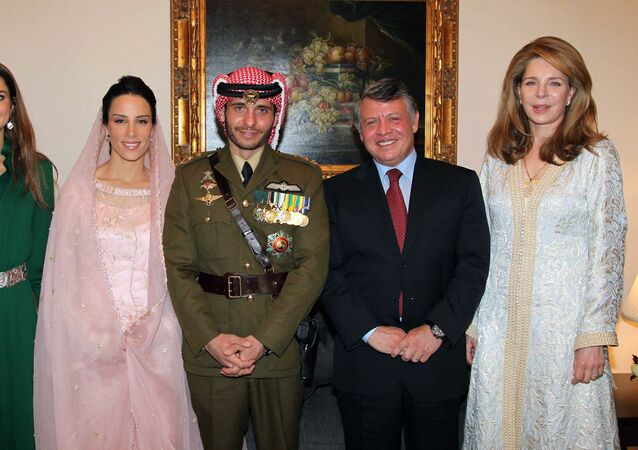 In this file handout picture released by the Jordanian news agency Petra on January 12, 2012, shows Jordan's King Abdullah (2nd R), Queen Noor, widow of late King Hussein (R), and Queen Rania (L) posing for a picture with Prince Hamzah, half-brother of Jordan's King Abdullah and his new wife Princess Basma Otoum during their  Muslim wedding ceremony at the Royal Palace in Amman