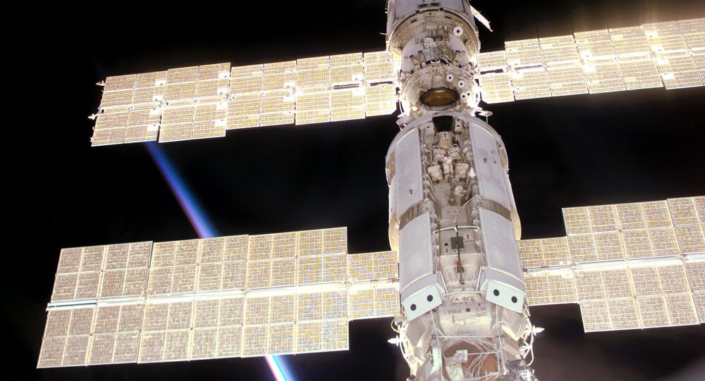 This photo provided by NASA shows the International Space Station as seen from Space Shuttle Atlantis during mission STS-106, which delivered supplies and performed maintenance in September 2000.