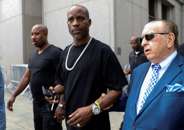 Earl Simmons (C), also known as the rapper DMX, exits the U.S. Federal Court in Manhattan following a hearing regarding income tax evasion charges in New York City, U.S., July 17, 2017.