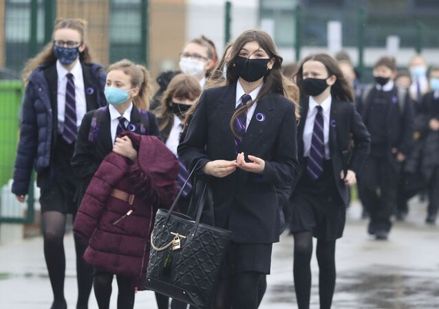 Pupils arrive at Outwood Academy in Woodlands, Doncaster, England, Monday March 8, 2021.