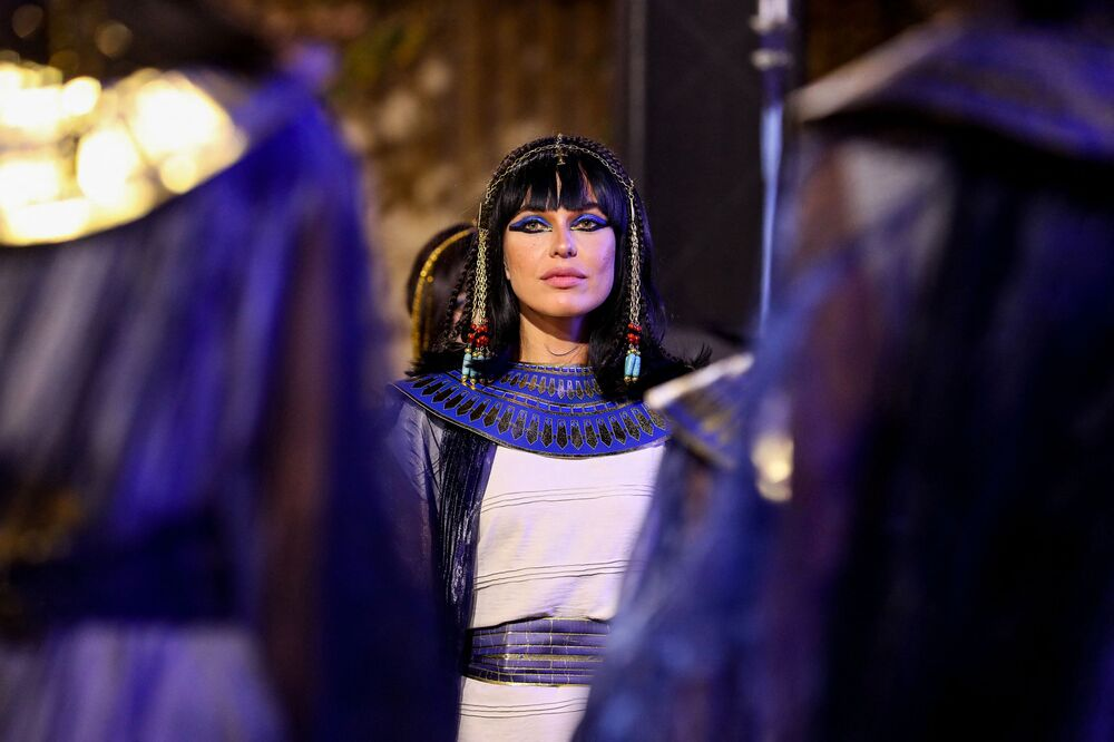 Performers dressed in ancient Egyptian costumes wait at the start of the parade of 22 ancient Egyptian royal mummies departing from the Egyptian Museum in Cairo's Tahrir Square on 3 April 2021.