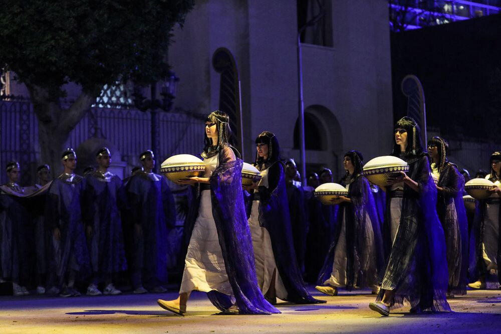 Performers dressed in ancient Egyptian costumes march at the start of the parade of 22 ancient Egyptian royal mummies, departing from the Egyptian Museum in Cairo's Tahrir Square on 3 April 2021, on their way to their new resting place at the new National Museum of Egyptian Civilisation (NMEC) about seven kilometres south in historic Fustat (Old Cairo).