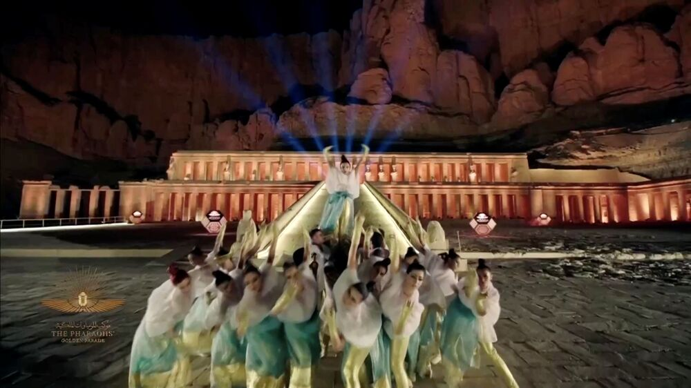 Artists perform in a video screened at a ceremony of a transfer of Royal mummies from the Egyptian Museum in Tahrir to the National Museum of Egyptian Civilisation in Fustat, in Cairo, Egypt 3 April 2021.