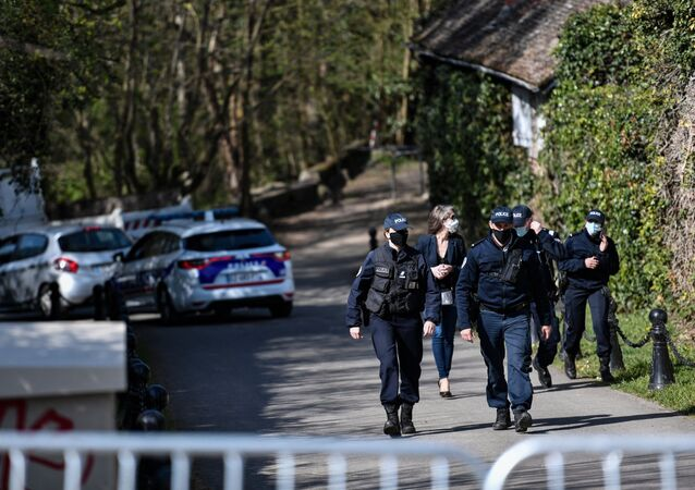 Police officers cordon off the area near the house of French businessman Bernard Tapie and his wife Dominique Tapie in Combs-la-Ville, southeastern suburbs of Paris, on April 4, 2021, after they were assaulted during the night by four men who entered their house before fleeing with jewellery.