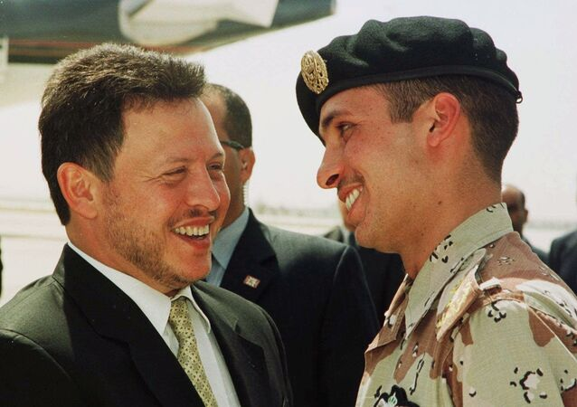 Jordan's King Abdullah II laughs with his brother Crown Prince Hamzeh, right, on Monday, April 2, 2001, shortly before the Jordanian monarch embarked on a tour of the United States